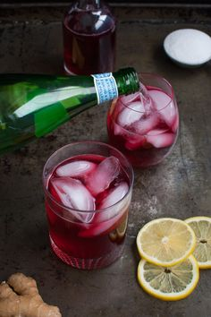 A refreshing non-alcoholic drink made with hibiscus tea, fresh ginger, lemon juice, and sparkling water. Perfect for any party from tamingofthespoon.com