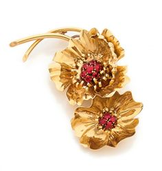 An 18K gold and ruby brooch by Van Cleef & Arpels, circa 1940.