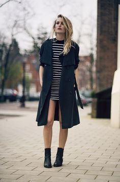 Le Fashion Blog Rainy Day Style Inspiration Black Trench Coat Striped Mini Dress Alexander Wang Anouck Chelsea Boots Cut Out Heels Via Raspb...