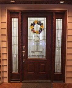Brown Entry Door With Flower Wreath. Please Call NEXT For All Of Your Entry  Door