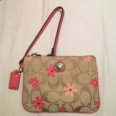 Coach Daisy Signature Floral Wristlet Clutch Authentic Coach. Given to me as a gift, but never has been used. No tags included. Perfect condition. Inside contains two pockets. Coach Bags Clutches & Wristlets
