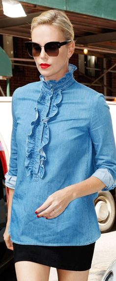Who made Charlize Theron's black sunglasses and denim ruffle top?