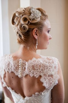 Bridal Applique Headpiece Melinda is a flattering applique sideheadpiece,delicately shaped with refined silver lined seed beads and diamante embellished organza combined to establish a faultless piece for a faultless bride.