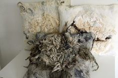 OMG I love this kind of rustic looking hand-felted functional art ---- these are felted pillows by German artist Brita Stein - ChameleonWool - Januar 2013