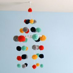 Add a personalized touch to your baby's nursery with this DIY pom pom mobile tutorial.