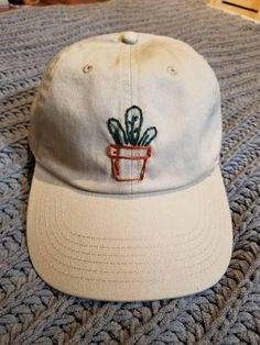 85de27f68d725 A hand embroidered potted plant on an adjustable hat Embroidery On Clothes