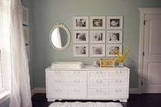 This symmetrical photo display would work in any room.  Photos by Kerianne Brown Photography.