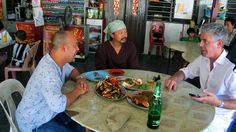 Tony Bourdain speaks with others in Penang
