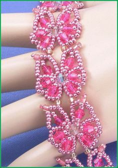 "05-416 Pink and Crystal Bicone, Seed Bead Butterfly Bracelet along with a Oval Filigree Clasp. ""FREE SHIPPING"""