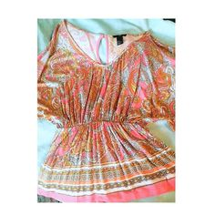 A Flow To My Shirt & Pep in My Step Very cute paisley print flowy bat wing top with a key hole closure in the back. Colors are pink, yellow, white and orange. No flaws. H&M Tops Blouses
