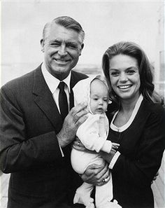 Film star Cary Grant (1904 - 1986) with his fourth wife Dyan Cannon and their baby daughter Jennifer on a visit to England.