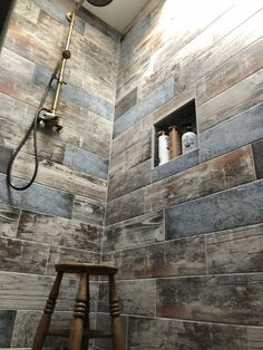 wood effect tiles and antique brass fittings for a rustic chic ways to give your bathroom a makeover 8 fabulous ideas industrial lighting fan cozy ind. Rustic Bathroom Shower, Wood Tile Shower, Rustic Bathroom Designs, Bathroom Interior Design, Master Bathroom, Bathroom Ideas, Cabin Bathrooms, Rustic Bathrooms, Wood Effect Tiles
