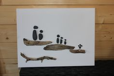 My first attempt.  This one was created when my long suffering husband began to question what on earth I was planning to do with the piles of driftwood and pebbles that seemed to be appearing in our house! :-)