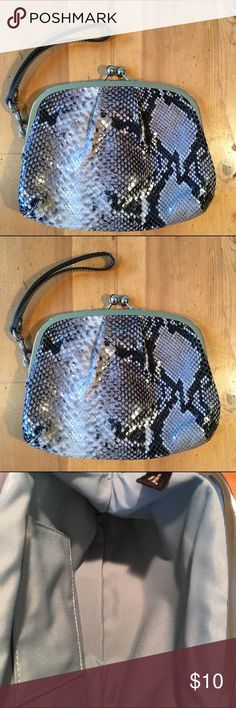 Snakeskin Wristlet Feels like snake skin but not sure. Never used excellent condition clasps shut inside spotless 7in long 8 in wide great basic good for everyday or a night out Bags Clutches & Wristlets