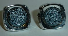 These original 1970s vintage Hickok cufflinks are one of my favourites. Silver plate and set with a synthetic blue stone to the centre which always reminds me of droplets of water - against the silver they really are quite effective and have a sparkling effect in the light - there a great addition to any suit