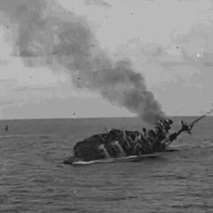 25 November 1941: Sailors jump from the hull of HMS Barham as she capsizes and her magazines explode.