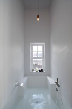 A seamless bath in an Amsterdam loft by architects Witteveen Architecten, who say they were looking to blend the wall with the bath. They worked with Hi-Macs, a solid surface material, to prefabricate the bath off-site and install it into the walls, blending the two together with plaster. Photograph courtesy of Witteveen Architecten.