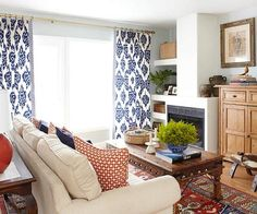 Bright patterned pillows stand out against a neutral sofa. More living room design ideas: http://www.bhg.com/rooms/living-room/makeovers/living-room-decorating-ideas/?socsrc=bhgpin082413redpillows=31
