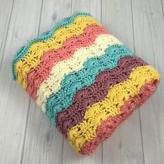 Chic handmade baby girl blanket with floral inspired colors by HookYarnAndHooper