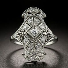 Artfully designed and composed of geometric, diamond-set sections arrayed within a striking curvaceous outline, this sparkling Jazz Age jewel, circa 1920s-30s, is beautifully crafted in platinum and glistens with just under a half-carat of bright white European-cut diamonds. 7/8 inch long, currently ring size 5 1/2.