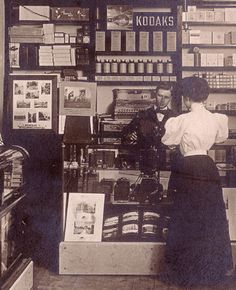 Vintage Camera kodak camera store and pharmacy, about 100 years ago - Check out this photo showing the inside of a camera shop (and pharmacy) from It's the image on a postcard that's currently being auctioned over on Vintage Pictures, Old Pictures, Old Photos, Antique Photos, Vintage Images, Belle Epoque, Camera Shop, Camera Stores, Kodak Photos