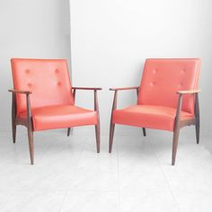 A pair of mid-century modern chairs have retro charm.