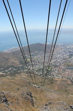This should be your first port of call on a trip to the Mother City. The cable way whizzes to the top of Table Mountain at 10 metres per second, all the while providing an easy path to the best views of the Mother City and her surrounds. Table Mountain Cape Town, Mountain Hiking, Africa Travel, South Africa, National Parks, Cable, Passport, Stamps, Top