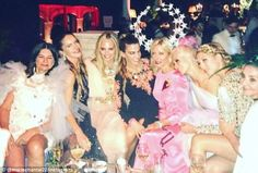 Double party: Her whole family (including her mom, fourth from right) was in attendance, s...