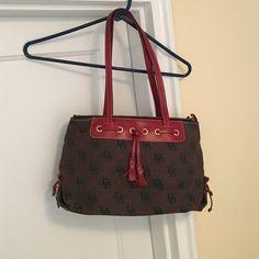 Dooney & Bourke Satchel Classical Dooney & Bourke satchel. Two pockets inside. zip closer. Dooney & Bourke Bags Satchels