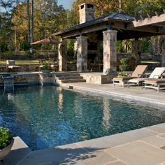 THIS IS GOOD. NARROW POOL WITH UPPER LEDGE. LEVELS, STEPS, ROCK, PERGOLA