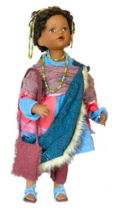Hillary Porcelain Ethnic Doll Hillary belongs to Cathay Collection and is limited to 5000 pieces world wide. It was designed by professional artists, and delicately handcrafted with the finest materials. It is 22 inches tall and comes with a Certificate of Authenticity