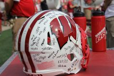 This helmet signed by all the players sits behind the bench during the game. Wisconsin Badgers, Bucky, Helmet, Bench, Football, Star, Game, Sports, Soccer