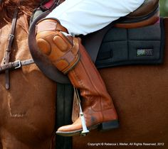 Polo boots with knee protectors.