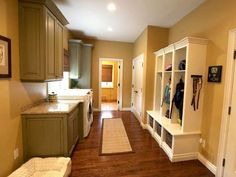 Mud Room InspirationThe Ercolani home in Bloomfield Hills has a mud room perfect for any family with or without pets. It has a custom built coat and play gear area, laundry facility with a granite counter top and added storage space for all cleaning products.