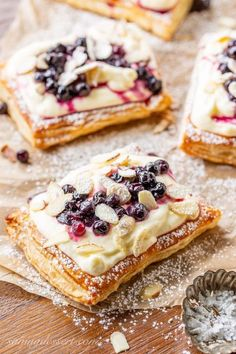 Blueberry Puff Pastry Tarts with Lemon Cream Blueberry Puff Pastry Tarts with Lemon Cream,Yum. Blueberry Puff Pastry Tarts with Lemon Cream, toasted almonds and powdered sugar appetizers and drink pastry recipes cabbage rolls recipes cabbage rolls polish Puff Pastry Desserts, Puff Pastry Recipes, Tart Recipes, Sweet Recipes, Baking Recipes, Puff Pastries, Puff Pastry Tarts, Pastries Recipes, Savory Pastry