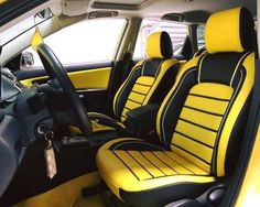 car auto interior yellow and black and grey with yellow carpet.