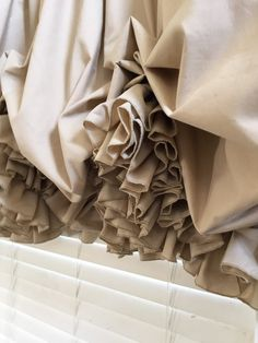 Fully lined, double ruffled balloon curtain made of of Roc-Lon Tea Dyed Light Muslin. Tea dyed muslin is a khaki color. It is a stationary balloon