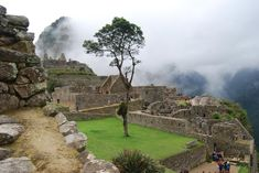 Machu Picchu: A view of the famous ruined city, The Best WOW Shot, Peru. Archaeologists have identified several distinct sectors that together comprise the city, including a farming zone, a residential neighborhood, a royal district and a sacred area. Machu Picchu's most distinct and famous structures.