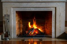 Wood burning in a cozy fireplace at home in interior. Fireplace as a piece of furniture. Christmas New Year concept decorations. Ventless Natural Gas Fireplace, Fireplace Vent, Propane Fireplace, Build A Fireplace, Custom Fireplace, Fireplace Inserts, Fireplace Surrounds, Fireplaces, Electric Fireplace Entertainment Center