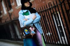 The Louis Vuitton Camera Messenger by Cindy Sherman for the Celebrating Monogram Collection was spotted on the streets of London during Fall 2015 #LFW - Photography by Adam Katz Sinding via @wmag