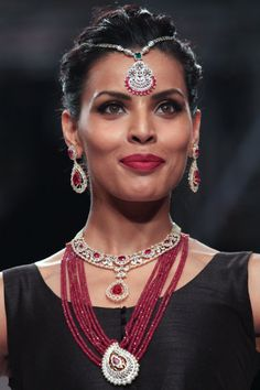 A model walks the runway at the GIA show on day 2 of India International Jewellery Week 2013 at the Hotel Grand Hyatt on August 5, 2013 in Mumbai, India.