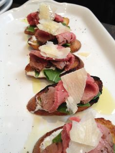 beef tenderloin with parmigiano reggiano and arugula on crostini from Joan's on Third, LA