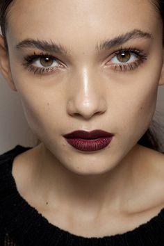 Dark lip look  Messy brow Illuminated skin