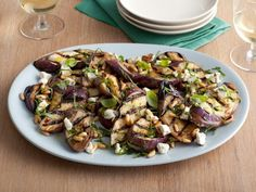 Recipe of the Day: Giada de Laurentiis' Grilled Eggplant and Goat Cheese Salad Brighten up thick slices of grilled Japanese eggplant with a handful of toasted pinenuts, creamy crumbled goat cheese, fresh herbs and a drizzle of balsamic vinegar and olive oil.