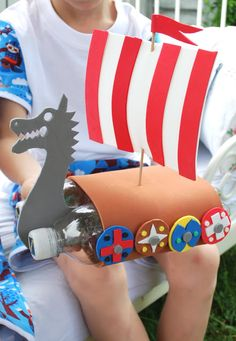 Pool at the party? Designate the pool Norway. Decorate with flags at pool stairway and Recycled Plastic Viking boats floating in water. NORWAY | Around the World Themed Party ideas decor games food