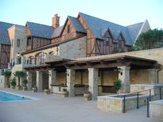 Here's a pergola with a hard top.  I like that it goes well with a variety of clubhouse styles.  Michael