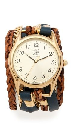 Supple leather and braided leather strips combine with glimmering 24k gold-plated curb-chain to add refined style to this menswear-inspired wrap watch. Adjustable length and lobster-claw clasp. Love this.
