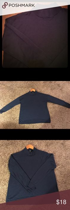 Uniqlo Navy Blue 100% Wool Sweater Uniqlo 100% wool navy blue mock neck sweater, only worn a couple times and in excellent condition! Only worn 2-3 times. Size large, feel free to comment if you need measurements. Uniqlo Sweaters Cowl & Turtlenecks