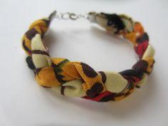 Bracelet ethnique en tissu africain noir rouge et jaune