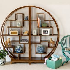 An elegant bookcase or room divider made from Chinese elm with a rich brown…